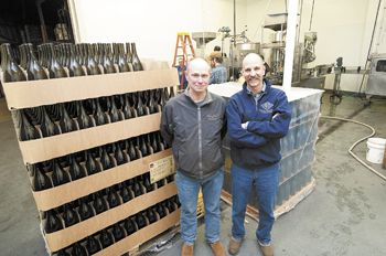 Allen Holstein, vineyard manager, and Rollin Soles, general manager/head winemaker, in the Argyle Winery bottling room. They've overseen operations since it opened a quarter century ago.