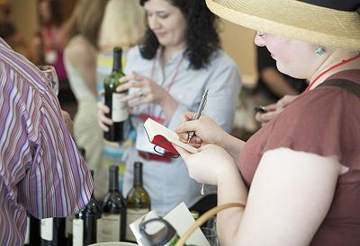 A participant at the 2011 Wine Blogger' Conference in Virginia takes notes after