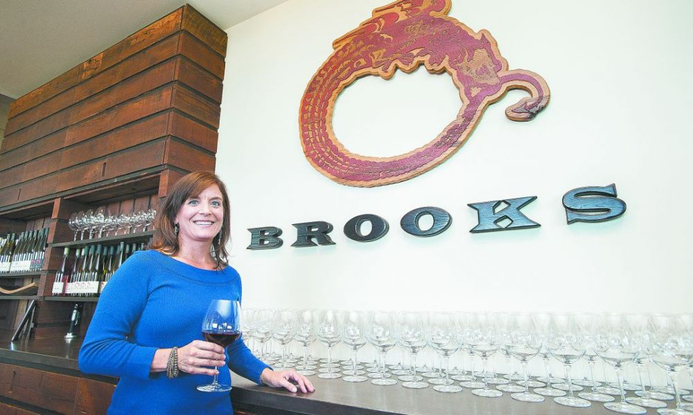 Janie Brooks Heuck has managed Brooks Winery since Jimi's death in 2004. The winery logo, an Ouroboros, is a mythical dragon symbolizing re-creation, which her brother wore as a tattoo. ##Photo by Marcus Larson