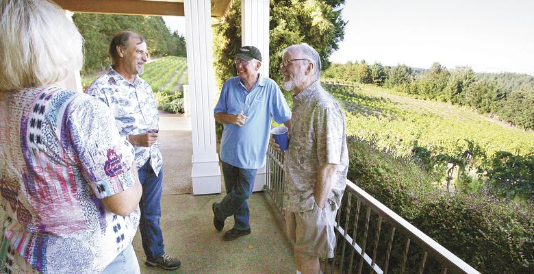 Susanna Brown (from left), Al McDonald, John Totten and Dick O'Brien chat during the Salem Growers' Group annual summer picnic, Aug. 3, at BeckenRidge Vineyard in Dallas. ##Photo by Rockne Roll