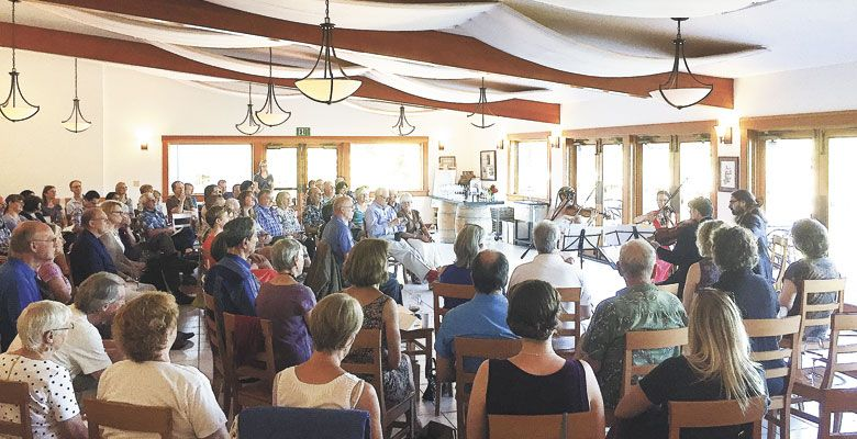 Guests enjoy the sounds of the Willamette Valley Chamber Music Festival at Elk Cove Vineyards on Aug. 21. ##Photo courtesy of Ken Friedenreich