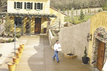 Dan Marca moves a case of wine to DANCIN Vineyards' cave for storage.