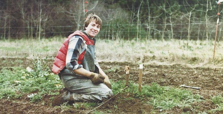 A young Joe Dobbes helps with his parents' vineyard located in East Willamette Valley. ##Photo courtesy of Dobbes Family Estate