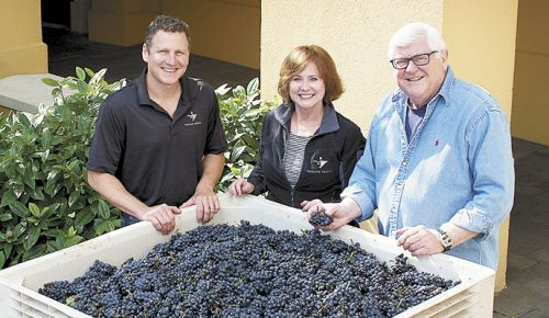 Domaine Serene winemaker Erik Kramer (left) with owners Ken and Grace Evenstad at the Dayton winery. ##Photo provided