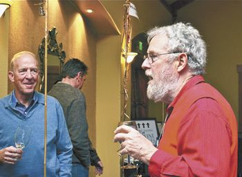 Myron Redford of Amity Vineyards talks with a guest at this year's Equinox, Eola-Amity Hills Winegrowers Association's annual tasting event.