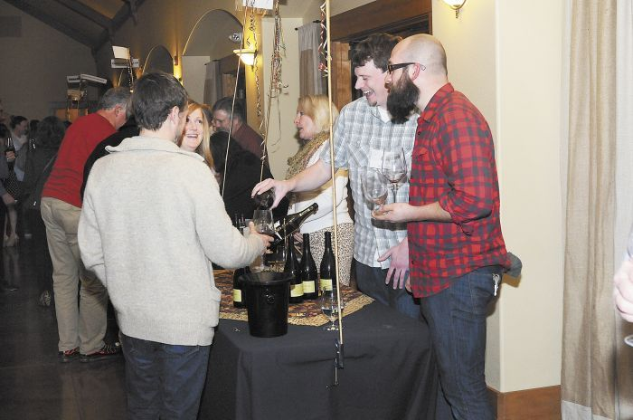 Winery representatives pour samples for guests at the 2014 event.