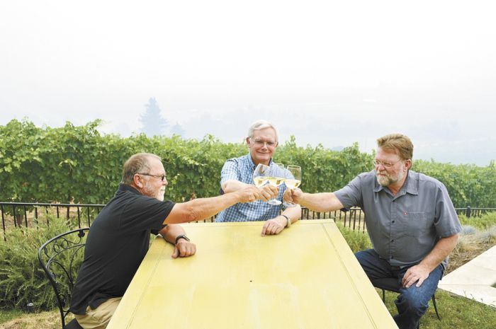 Rogue Valley growers Cal Schmidt, Lee Mankin and Joe Ginet hope for the best despite smoke lingering over Southern Oregon vineyards such as Mankin's Carpenter Hill Vineyard in Medford. Photo by Janet Eastman.