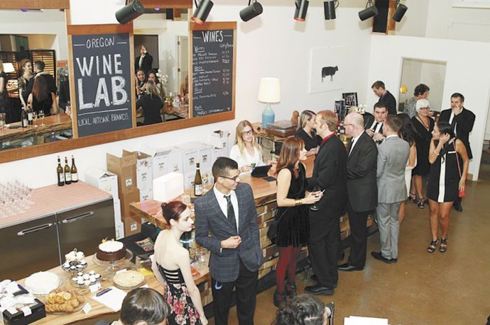 Guests sample wine and enjoy evening festivities during the grand opening of Oregon Wine LAB in downtown Eugene. Photo by Abra Cohen.