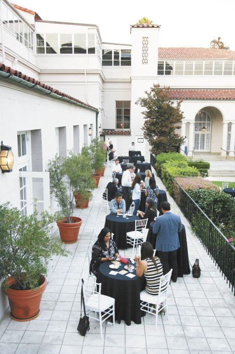 Attendees gather in the courtyard of The Ebell in L.A. Photo by Mark Stock.