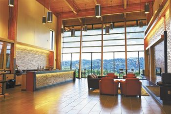 The airy tasting room looks out on nearby hills and