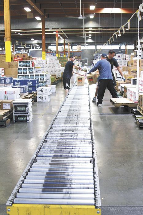 Frequently ordered items stand adjacent to the main conveyer line at the OLCC's 230,000-square-foot warehouse in Southeast Portland. Photo provided.