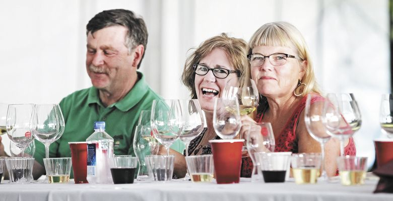 Friends attend the Riedel seminar, a part of the celebration's Oregon Wine University. ##Photo by Steven Addington Photography