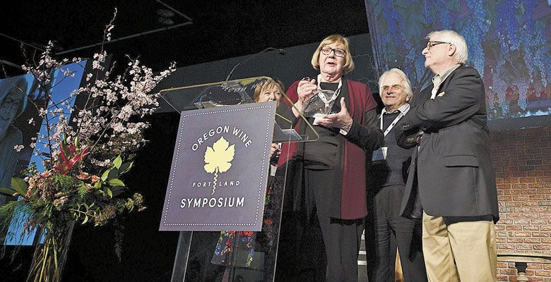 Sue Horstmann accepts the 2017 Lifetime Achievment Award presented by David Adelsheim and Harry Peterson-Nedry at the Oregon Wine Symposium at the Oregon Convention Center in Portland. ##Photo by Carolyn Wells Kramer