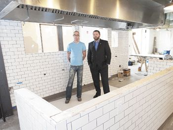 Paulée owners, Executive Chef daniel Mondok (left) and Sommelier Brandon tebbe, stand in what will be dundee's newest upscale restaurant, set to open in May.