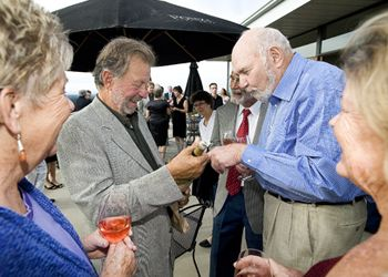 Dick Ponzi (left) and Dick Erath chat before the dinner begins. Photo by Marcus Larson.