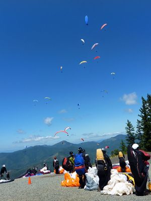 Participants in last year's paragliding competition get ready to launch off Woodrat Mountain, only two miles from Fiasco Winery, near Jacksonville.