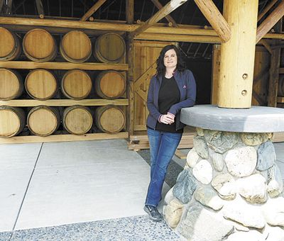 Rachael Martin stands in front of the new Red Lily Vineyards Tasting Room in Jacksonville. Photo provided.