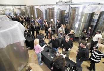 Of the 42 wineries pouring their 2010 ¡Salud! cuvée Pinot Noirs during the annual barrel auction at Domaine Drouhin Oregon, 18 were stationed on the main fermentation floor. Photo by Marcus Larson/News-Register