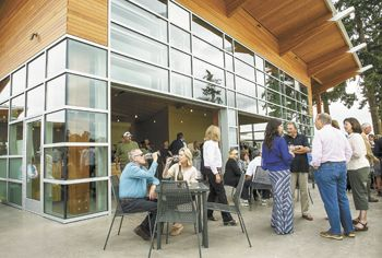 Guests gather on the patio at the new Stoller tasting room in Dayton during its grand opening on Sept. 9.