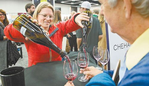 Wynne Peterson-Nedry pours Chehalem Wine during an experimental tasting at this year's Oregon Wine Symposium. ##Photo by Carolyn Wells-Kramer
