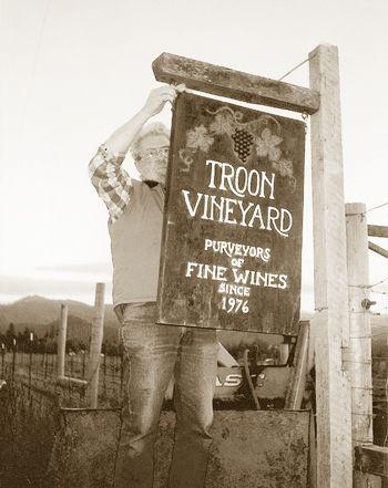 A young Dick Troon hangs a winery sign in 1976 at his Applegate Valley vineyard.