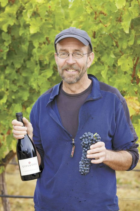 Upper Five owner Terry Cooper Sullivan holds a bottle of Upper Five 2010 Tempranillo, which received 90 points from Wine Spectator. The wine was Sullivan's first vintage. Photo provided.