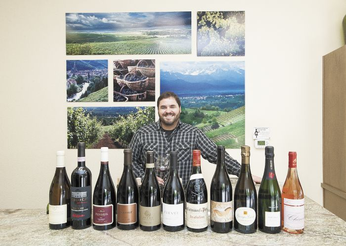 Jeff Woodard, owner of newly opened Woodard Wines, displays a selection of favorites from his inventory.Photo by Marcus Larson