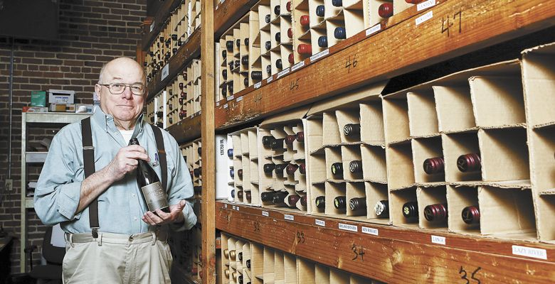 Nick chooses a wine inside the restaurant's wine cellar, a collection he started 40 years ago. ##Photo by Rockne Roll
