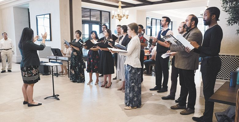 In 2018, Danielle Jagelski conducts the Aquilon Young Artists Choir at the Domaine Serene Clubhouse in Dayton. ##Photo by John Pak