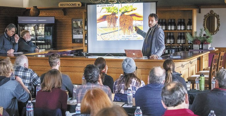 During a pre-conference gathering at Montinore Estate before the 2018 International Biodynamic Conference in Portland, Italian Biodynamic consultant Adriano Zago compares roots in soil farmed Biodynamically versus conventionally. ##Photo by Andrea Johnson