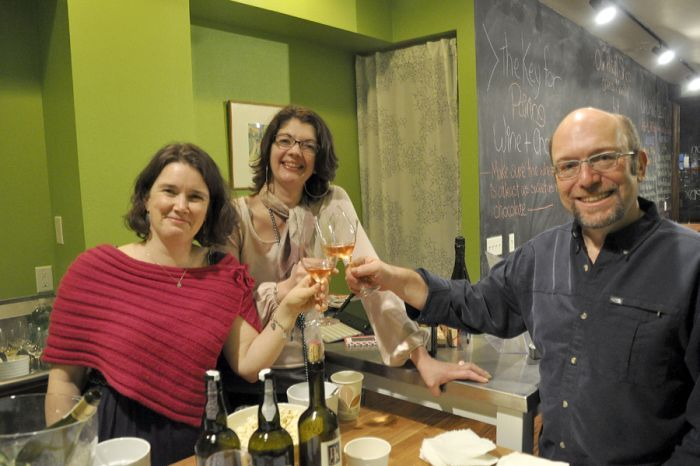Pairings Portland owners Jeffrey Weissler (right) and Megan Wilkerson (left) toast the new wine shop with friend Beverly McKenzie, a fellow wine aficionado.
