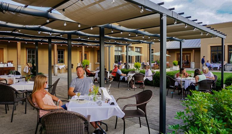 The patio at The Dundee Bistro buzzes with customers enjoying dinner outside. ##Photo provided.