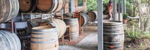 The tasting room at Varmum Vintners in Amity takes care to separate guests using barrels.  ##Photo provided