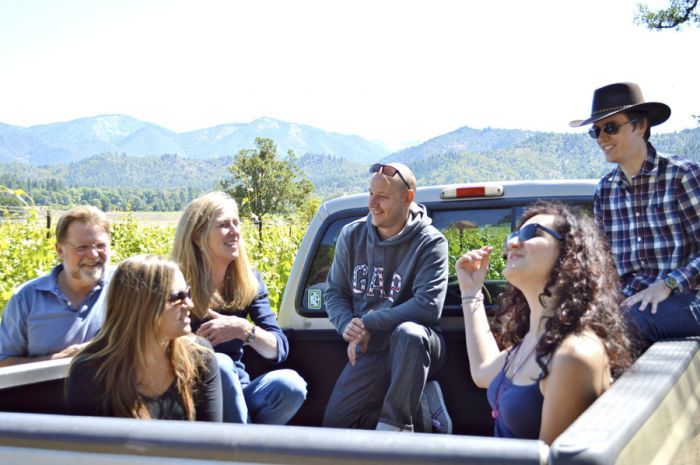 Joe and Suzi Ginet of Plaisance Ranch in Williams give French visitors, from left, Vaite Redolat, Cedric Buffet, Julie Laforet and Bruno Carle, their first trip in a pickup on the way to work in the vineyards. Photo courtesy of Mail Tribune/Janet Eastman.