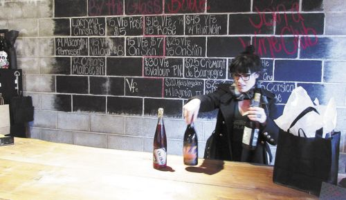 Winemaker/owner Natalie Bowman works the Vinum FeRus tasting room in McMinnville. ##Photo provided.