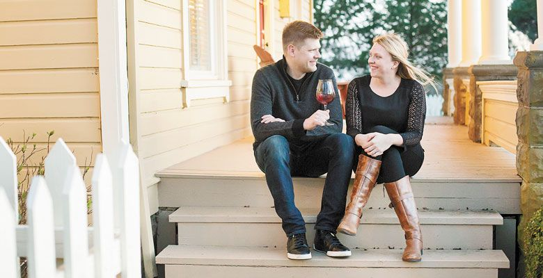 Bryan and Laura Laing, owners of Hazelfern Cellars in Newberg, relax on the porch of their old farmhouse located on the same property as their new winery. ##Photo provided.