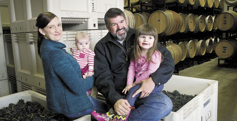 Megan and Mark McNeilly inside the couple's Woodinville winery, Mark Ryan, with their daughters in tow. ##Photo by Andrea Johnson