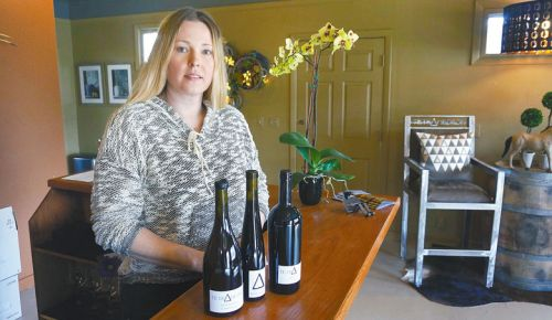 Kelly Johnson sells her wines out of Tetrahedron's tasting room in Lyle, Washington. ##Photo by Stuart Watson.