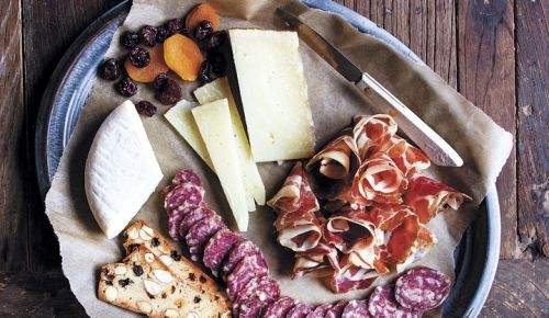 Slices of fennel salami, from Chop in Portland, and coppa rosettes, from The Beautiful Pig in Longview, Washington, accompany six-month aged Manchego and sheep's milk Robiola. ##Photo by Christine Hyatt