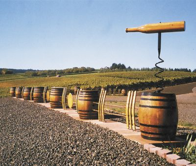 Wine barrels, a massive cork screw and barrel staves create a dramatic fence line adjacent to Sims Estate Vineyard at Barrel Fence Cellars in Dundee.