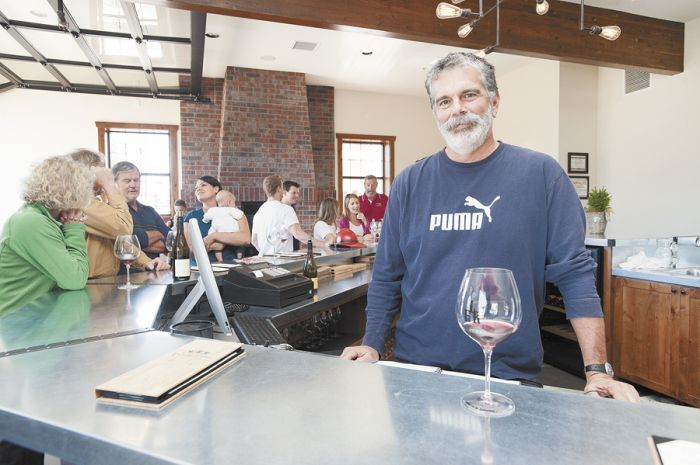 De Ponte Cellars owner Scott Baldwin welcomes guests to his new tasting room in downtown Carlton. Photo by Marcus Larson.