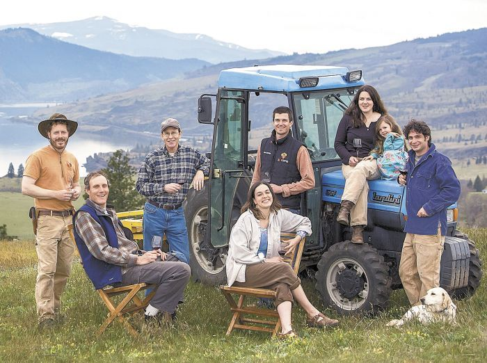 Members of the Lyle, Wash., creative collective include, from left, Brian McCormick of Memaloose Wines, Alexis Pouillon of Domaine Pouillon, Rob McCormick, Juliet Pouillon (seated), Luke Bradford of COR Cellars, Poppie Mantone, her daughter, Ava, and James Mantone. Photo by Patrick Bennett.