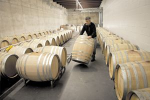 Steve Goff, winemaker for Colene Clemens, prepares a barrel for Pinot Noir in the winery's state-of-the-art facility.