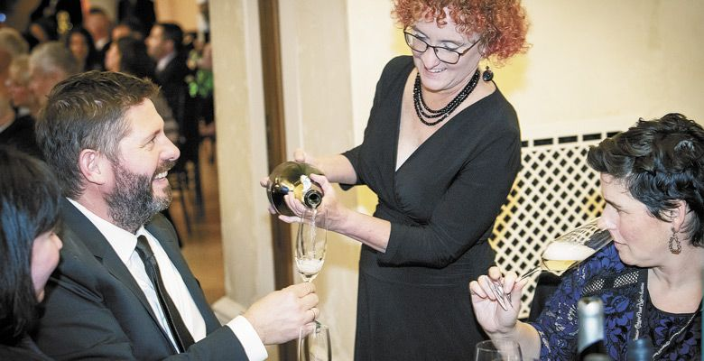 Mich Nelson pours sparkling for winemaker Josh Bergström and his wife, Caroline, at the Saturday gala hosted by Domaine Serene.  ##Photo by Andrea Johnson