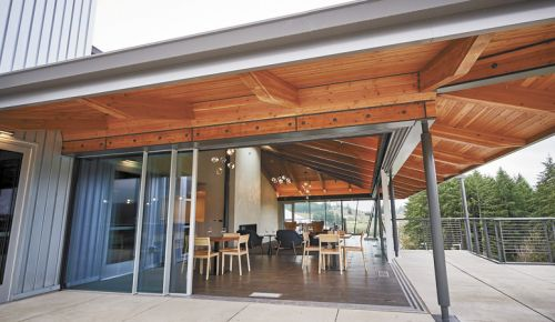 Retractable floor-to-ceiling glass walls allow the outside in at the new REX HILL tasting room and hospitality center in Newberg. The surrounding deck overlooks the vineyard, giving guests even more room to enjoy wine and relax. ##Photo courtesy of REX HILL