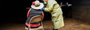 Miriam Lopez, ¡Salud! clinical outreach team assistant, gathers necessary medical information from a vineyard worker attending the mobile clinic at Willakenzie Estate outside Yamhill. ##Photo by Kathryn Elsesser