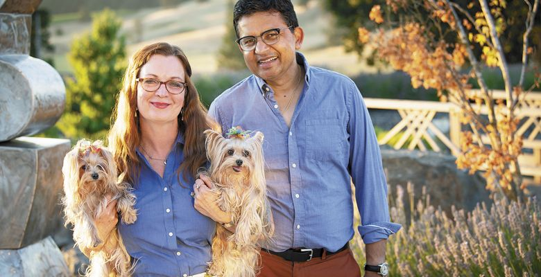 Saffron Fields Vineyard owners Angela Summers and Sanjeev Lahoti outside the tasting room. Summers holds their flower children; Yorkshire terriers Daisy (left) and Iris. ##Photo by Andrea Johnson