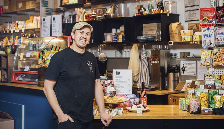 Erik Hanson, saké buyer at Giraffe Goods. Look for a variety of sakés at the Japanese deli and shop located inside Cargo in S.E. Portland. ##Photo by Kathryn Elsesser