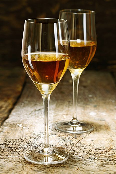 Sherry is produced in a variety of dry styles made primarily from the Palomino grape, ranging from light versions similar to white table wines, such as Manzanilla and Fino, to darker and heavier versions that have been allowed to oxidize as they age in barrel, such as Amontillado and Oloroso.