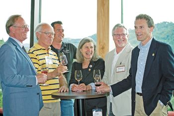 From left, Chris Lake, director of SOWI; Earl Jones of Abacela; Chris Martin of Troon Vineyard; Deb Hatcher of REX HILL and A to Z Wineworks; Michael Donovan of RoxyAnn Winery; and Tom Danowski, executive director of the Oregon Wine Board, enjoy wine and hors d'oeuvres at the Southern Oregon marketing and sales conference. Photo by Kim Lewis